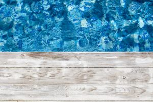 Swimming-pool-and-wooden-deck-ideal-for-backgrounds-801239442_5518x3679